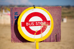 Red bus stop sign in the middle of Nowhere Royalty Free Stock Images