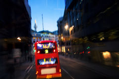 Red bus on street by night in London Stock Photos
