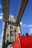 Red bus tour driving across The Tower Bridge in London, England Royalty Free Stock Photo