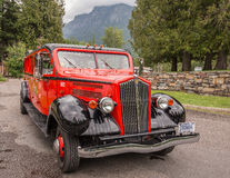 Red Bus Tours in Glacier National Park Stock Photo