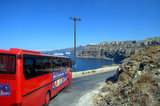 Red bus traveling down the harbor and coastline Royalty Free Stock Photo