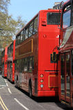 Red Buses. Queue of double decker buses in London, England Stock Photos