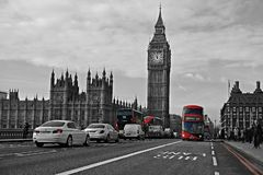Red buses in black and white photo Royalty Free Stock Photos