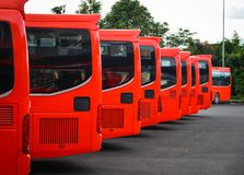 Red buses parking at station. Red buses parking at the main station in Dalat, Vietnam Royalty Free Stock Photo