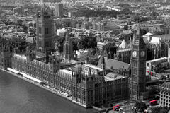 Red Buses at Westminster. Houses of Parliament, London in black & white with London buses highlighted in colour Royalty Free Stock Image