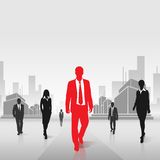 Red businessman silhouette over city background Stock Images