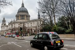 Red busses and cars  in front of Saint Pauls Cathedral in London. London, UK- January 12, 2018:Red busses and cars  in front of Saint Pauls Cathedral in London Stock Image