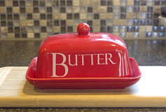 Red Butter Dish On Kitchen Counter Stock Photos
