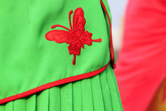 Red butterfly embroidered on the green clothes Royalty Free Stock Photography