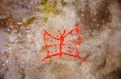 Red butterfly on wall. imitation cave painting,. Red butterfly on wall. imitation cave painting stock photos