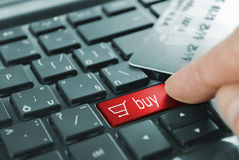 Red button buy. Red buy cart button or key on black keyboard Stock Photo