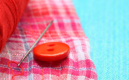 Red button on a cotton cloth Royalty Free Stock Image