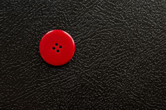 Red Button. A large red button on a black background Royalty Free Stock Photos