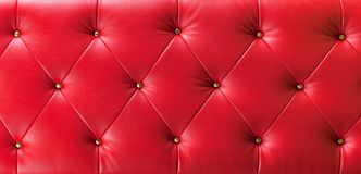 Red button leather background Royalty Free Stock Photos