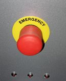 Red button on metallic surface, security concept Stock Photos