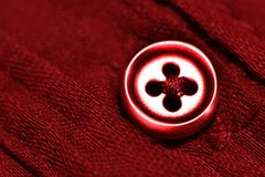 Red Button on Red Shirt Royalty Free Stock Image