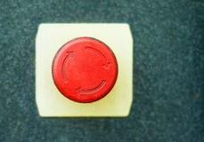 Red button with rotation symbol Royalty Free Stock Images