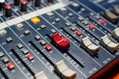 Red Button Studio Mixer. Studio mixer with red sliding volume button Royalty Free Stock Photography