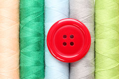 Red button and thread. Red button on colorful thread Royalty Free Stock Image