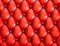 Red button-tufted leather background. Stock Images