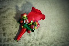 Red buttonhole flower. On background Stock Photography