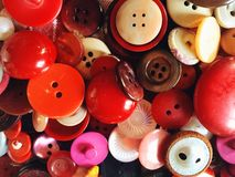 Red buttons close-up. Colorful red buttons Stock Images