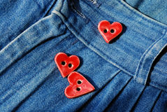 Red buttons for jeans Stock Images