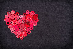 Red buttons in shape of heart Royalty Free Stock Image