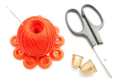 Red buttons, thimble, scissors and thread Stock Images
