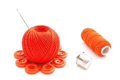 Red buttons, thimble and thread on white Stock Image