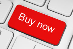 Red buy now button. Red buy now keyboard button stock photos