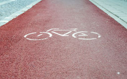 Red bycicle path. In a small town Stock Photography