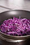 Red cabbage. In frying pan Stock Photos