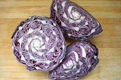 Red cabbage. On a wood background Royalty Free Stock Images