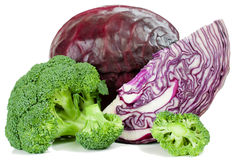 Red cabbage and  broccoli. Fresh  broccoli,  red cabbage and a cut   on a white background Royalty Free Stock Photo