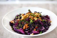 Red cabbage cooked with raisins, walnuts and thyme Royalty Free Stock Photography