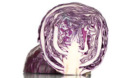 Red cabbage. Cross section on white reflective background Royalty Free Stock Photos