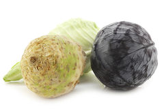 Red cabbage,green pointed cabbage and a celery root Royalty Free Stock Photos