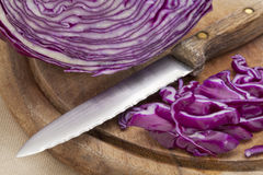 Red cabbage and knife Stock Image