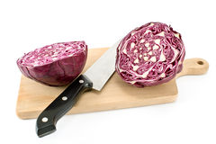 Red cabbage with knife and cutting board Royalty Free Stock Photo