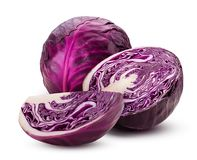 Red cabbage one cut in half and slice. Isolated on white background. Clipping Path. Full depth of field stock photography