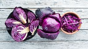 Red cabbage. Purple cabbage on a white wooden background. Organic food. Top view. Free space for your text stock photography