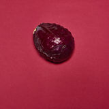Red cabbage on a red background Stock Image