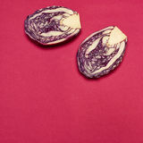 Red cabbage on a red background Royalty Free Stock Photography