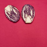 Red cabbage on a red background Stock Photos