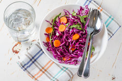 Red cabbage salad with carrot and arugula Royalty Free Stock Photos