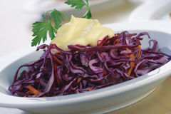 Red Cabbage Salad With Mayonnaise. Close-up picture of a salad from red cabbage with mayonnaise and parsley Stock Photography