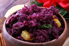 Red Cabbage salad with orange and pecan nuts for Christmas dinne. R. Vegetarian dish Royalty Free Stock Photos