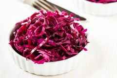 Red cabbage salad on white background Stock Images