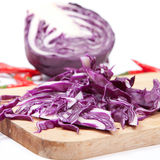 Red cabbage. Slice on wood chopping Royalty Free Stock Photos